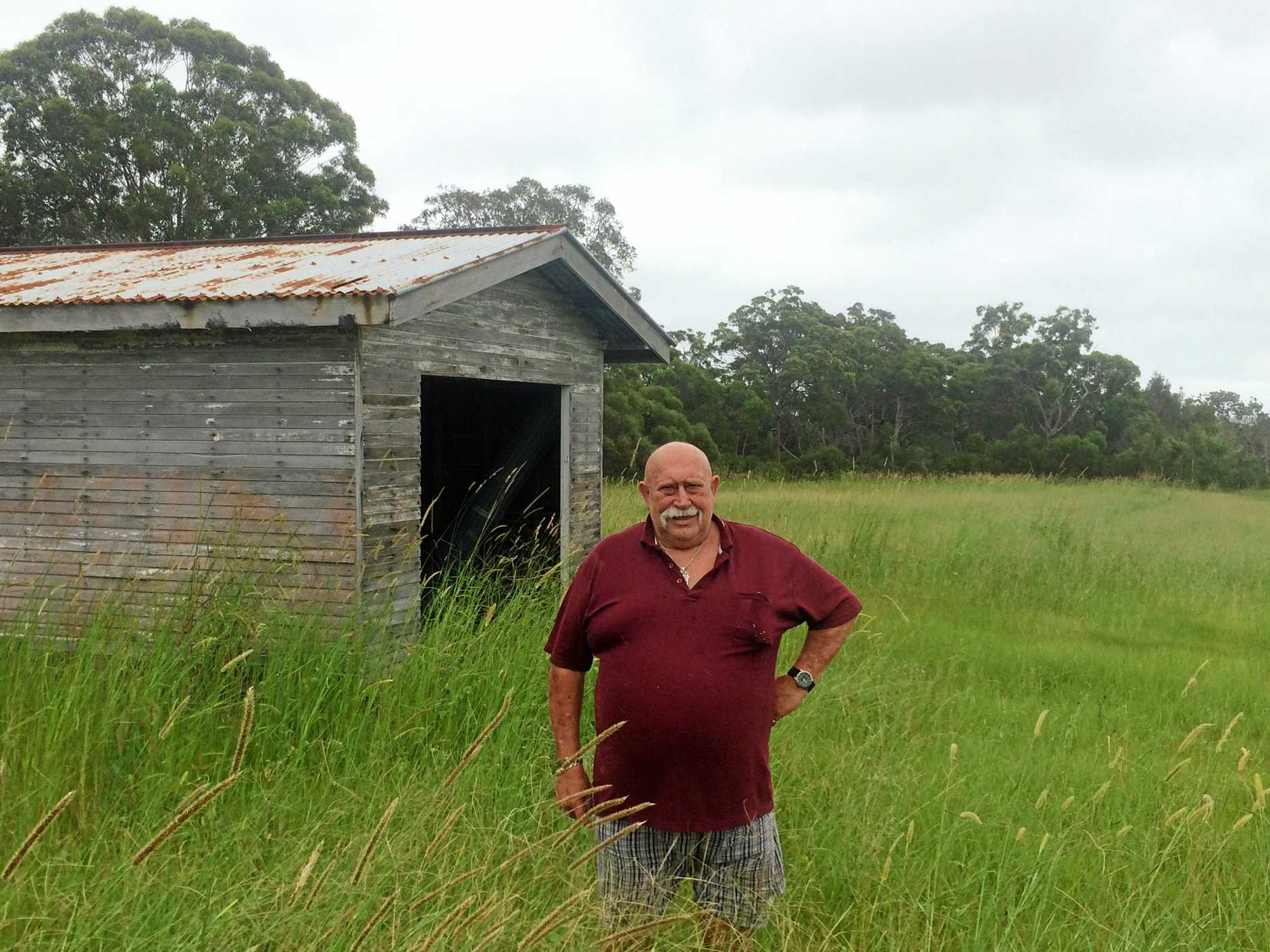 HAD ENOUGH: Tin Can Bay Resident is fed up with the state of two privately owned vacant lots neighbouring his home.