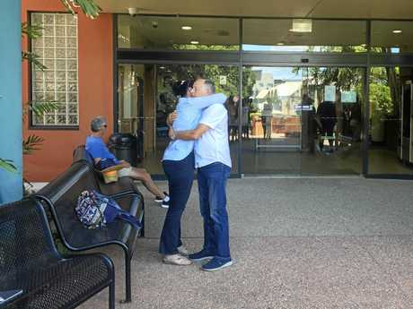 SAD: Tracy's father Bryan Loakes and sister Lisa Marie Brookes hug outside the court house in Gladstone