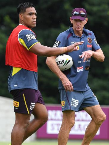 Joe Ofahengaue takes a few tips from Broncos coach Wayne Bennett at training on Monday. Picture: AAP/Dave Hunt