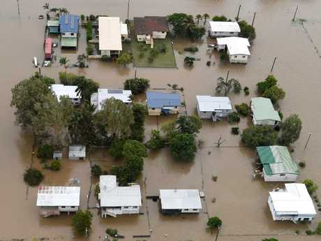 Houses are inundated with flood waters in Ingham in North Queensland.. (AAP Image/Dan Peled) N