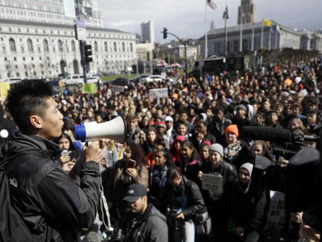 Steven Gong, left, a student at San Francisco's Lowell High School speaks to a group of demonstrators during a rally and march against gun violence. Picture: Marcio Jose Sanchez