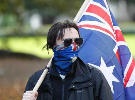 A protester near the exhibition building in Melbourne. While immigration is a heated debate, those that do settle here find their lives much improved. Picture: David Crosling