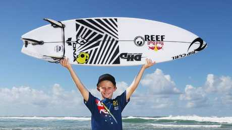 Nate Johnson plans to hang Mick Fanning's board on his wall. Picture Glenn Hampson