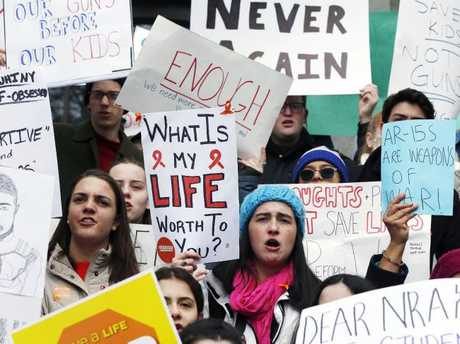 Boston area high school students rally on the steps of the Statehouse in Boston. Picture: AP