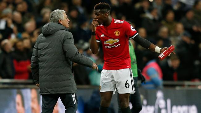 Manchester United's Jose Mourinho talks with Paul Pogba.