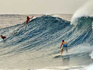 Surfers enjoy the rough swell at Snapper Rocks.