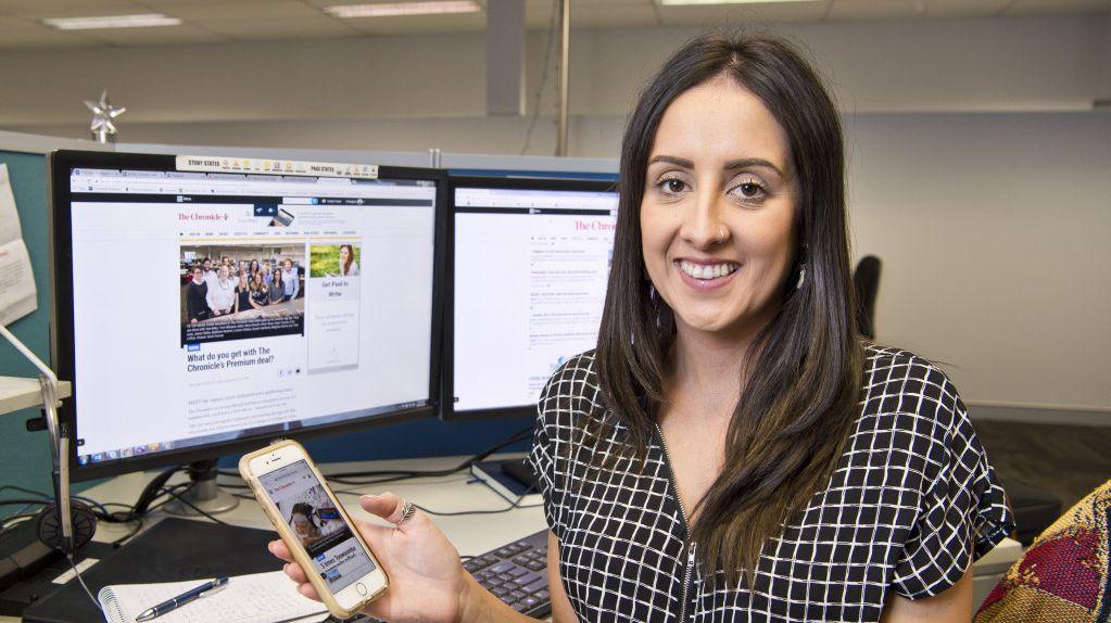 The Chronicle digital producer Meghan Harris keeps an eye on the website.
