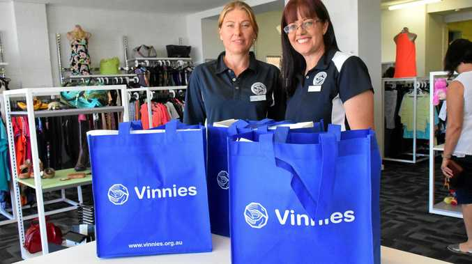 REDUCE, REUSE: Volunteer Jamie Newell and employee Sarah O'Dwyer at Gladstone's St Vincent de Paul shop say regular customers keep using the organisation's enviro bags.