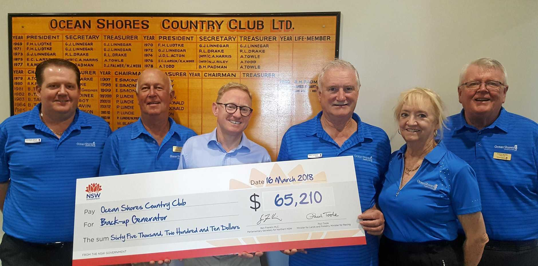 GENERATION: Nationals Parliamentary Secretary for Renewable Energy Ben Franklin, presenting the funding to the Club - General Manager Andrew Spice, Golf Director Ian Wingad, Chairman Peter Tomaros, Treasurer Anne Slater, and Director Tony Dahl.
