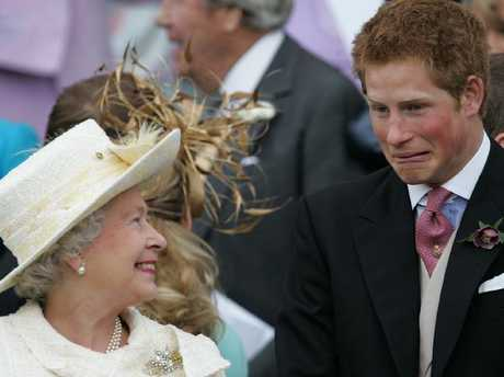 Queen Elizabeth II laughs with Prince Harry at Prince Charles and Camilla's wedding in 2005. Picture: Supplied