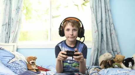 Tom Benhiam, 11, is one of many youngsters obsessed with the Hunger Games-style video game Fortnite: Battle Royale. Picture: Darren Leigh Roberts