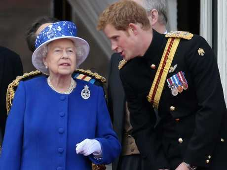 Queen Elizabeth II with Prince Harry in 2013. Picture: Getty