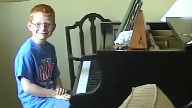 Ed Sheeran as a child at his piano.