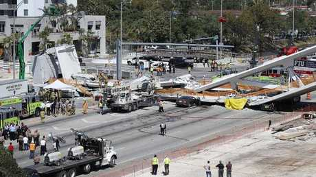 A pedestrian bridge collapsed just a few days after it was built. Picture: Joe Raedle/Getty Images/AFP.
