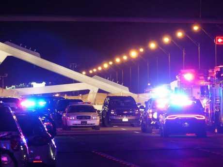 Police lights illuminate the scene of a pedestrian bridge collapse in Miami. Picture: AFP