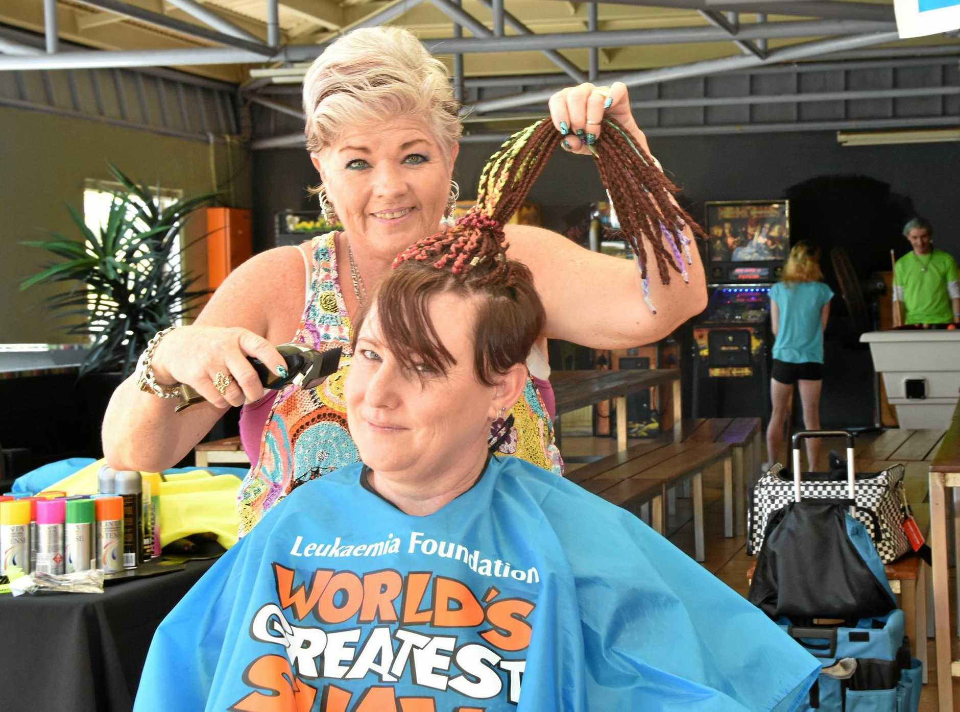 Hair dresser Lauren Powell gives Alicia Armstrong an interesting new cut.