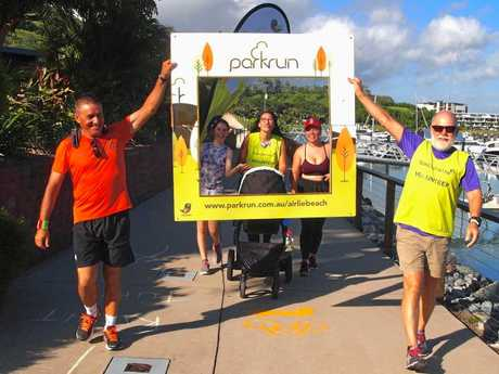 This week's Airlie Beach parkrun volunteers pose up for a post run photo.