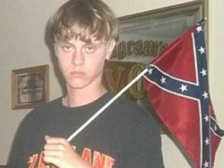 Charleston church shooter Dylann with a Confederate flag inside his South Carolina home.