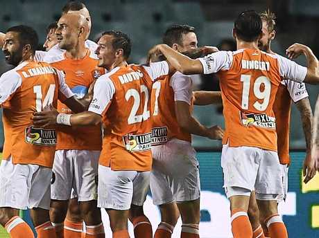 Brisbane Roar players celebrate Jacob Pepper's goal.