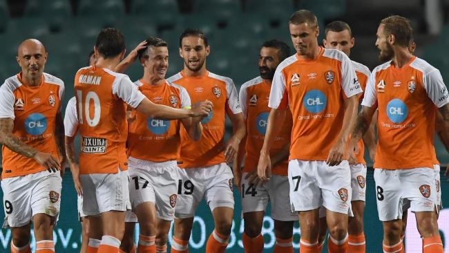 Brisbane Roar players celebrate Matt McKay's goal.