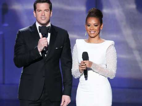 Former Spice Girl Mel B (pictured with Thomas Roberts) struggled with her appearance at the 2013 Miss Universe pageant. Picture: Victor Boyko/WireImage