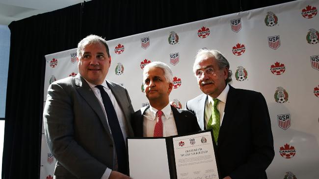 Sunil Gulati, (center) president of the United States Soccer Federation (USSF), Canadian CONCACAF President Victor Montagliani (left) and Mexican Football Federation President Decio De Maria hold up a signed unified bid for the 2026 soccer world cup