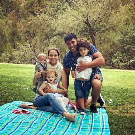MAKING A DIFFERENCE: Gerado and Amy Iacullo with their three children Romeo, 4, Mia, 2 and 8-month-old Mateo. Amy has started a blog to further autism awareness, offer tips for parents and inspire people to embrace