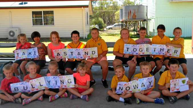 Kogan State School students created a banner for the National Day of Action.