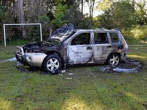 Car torched on local sporting field
