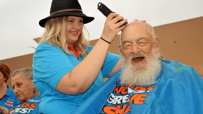 SHAVE IT OFF: Harry Wasley, 93, says goodbye to his beard and hair at the Fraser Coast's shave for a cure event at Hervey Bay Stockland. (Left) He received a certificate after shaving.