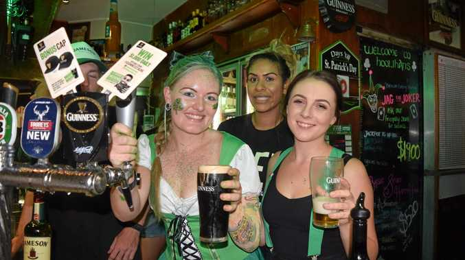 SLAINTE: Hoolihans events manager Sarah Collins, Davene Butterworth and Jaimee Harris pour beers during St Patricks Day celebrations at Hoolihans Irish Restaurant and Bar.