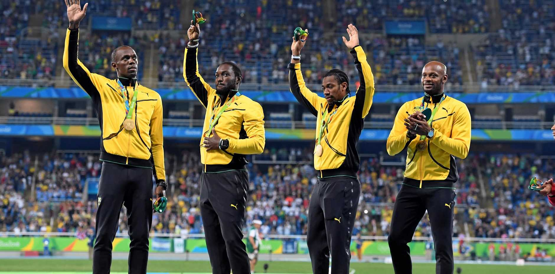 Usain Bolt, Nickel Ashmeade, Yohan Blake and Asafa Powell acknowledge the crowd's applause after receiving their gold medals for winning the 4x100m relay at the Rio Oympics.