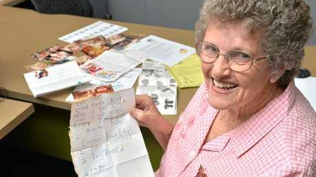 Marie Murray with Christmas memorabilia. Photo Tony Martin / Daily Mercury
