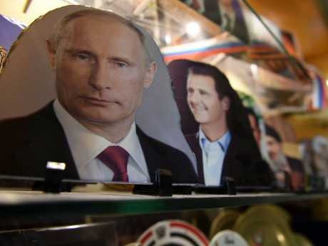 A portrait of Russian President Vladimir Putin at a jewellery shop in the northern Syrian city of Aleppo. Picture: AFP