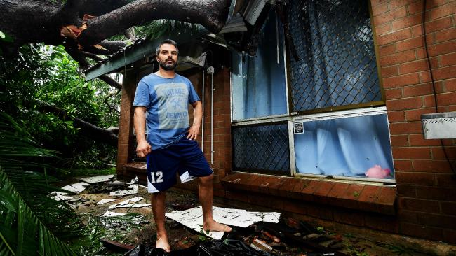 Thanasi Zaimakis was devastated after a massive African Mahogany tree crushed his recently renovated house in Karama. Picture: Justin Kennedy