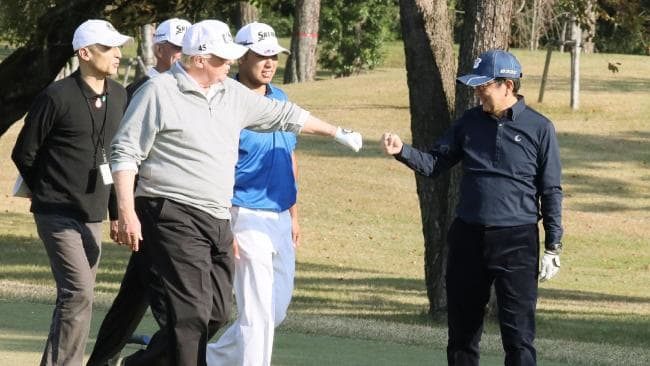 Donald Trump, pictured with Japanese Prime Minister Shinzo Abe (right) while playing golf with Japanese professional golfer Hideki Matsuyama. Picture: AFP