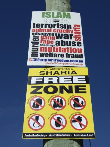 Racist signs placed on a telegraph pole opposite Dee Why Mosque, on South Creek Road in March, 2015. Picture: Troy Snook