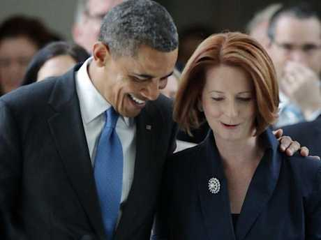 Barack Obama and Julia Gillard exit the House of Representatives in 2011. Picture: Alex Ellinghausen