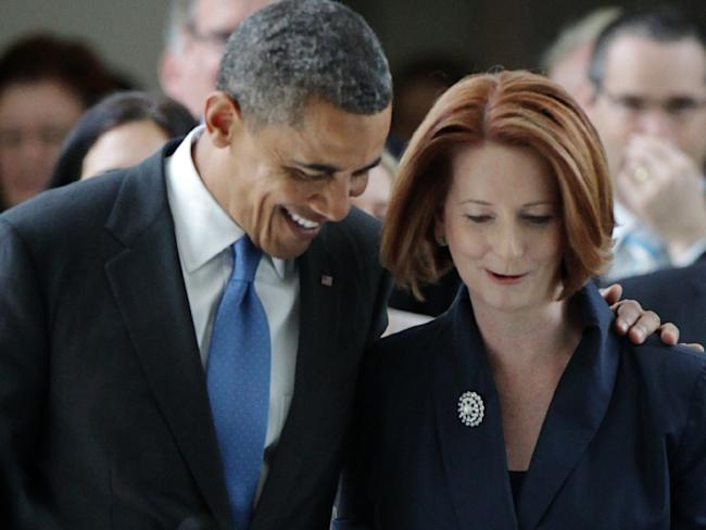 Barack Obama and Julia Gillard exit the House of Representatives in 2011. Picture: Alex Ellinghausen