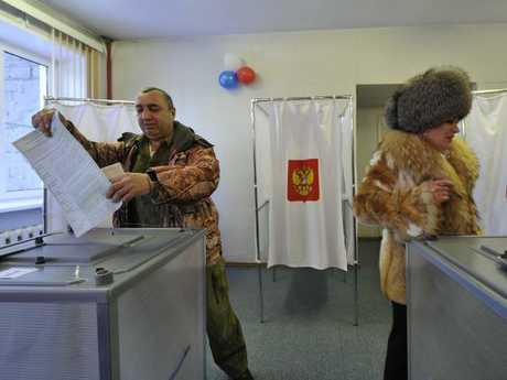 Fur real. Russians cast their ballots at a polling station in Yelizovo. Picture: AP