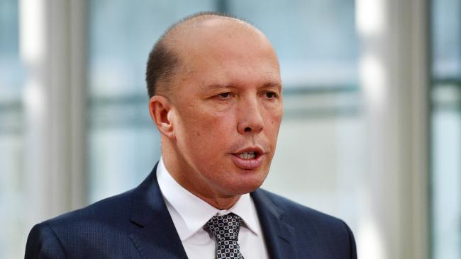 Minister for Home Affairs Peter Dutton is being urged to withdraw comments made about 'white' South African farmers. (AAP Image/Mick Tsikas)