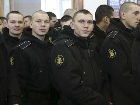 Russian military sailors line up to cast their ballots at a polling station in the Russian Far Eastern port city of Vladivostok. Picture: AP