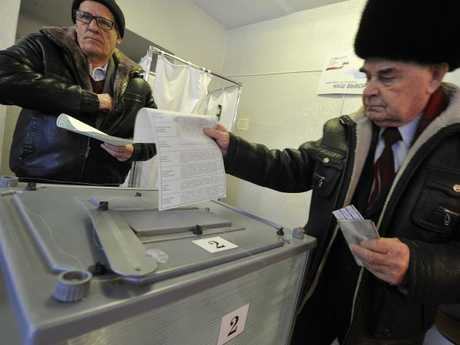 Two men cast their votes at a polling station in Yelizovo. Picture: AP