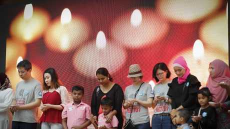 Relatives of passengers on board the missing Malaysia Airlines Flight 370 have a moment of silence during the Day of Remembrance for MH370 event in Kuala Lumpur, Malaysia. Picture:AP/Vincent Thian, File