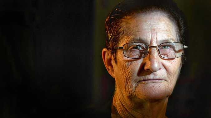 Pensioner whose backyard sank into hole robbed