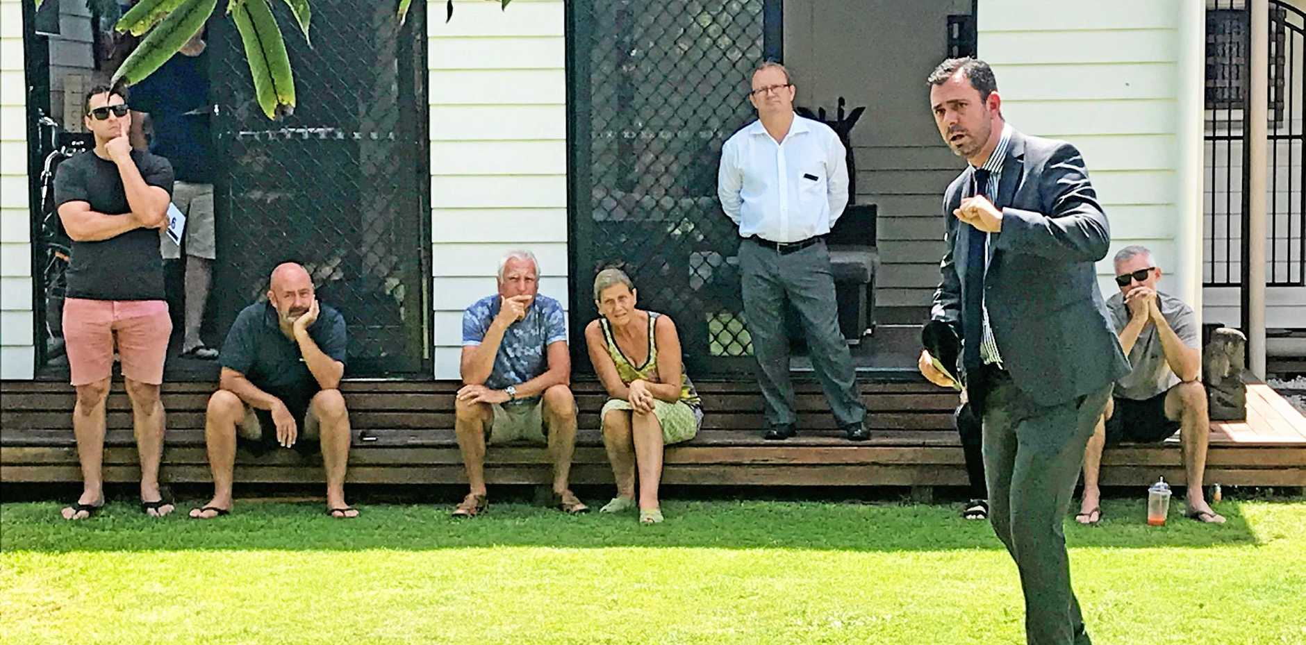 James Bell calls the bidding at 111 Parker St in Maroochydore on Saturday.