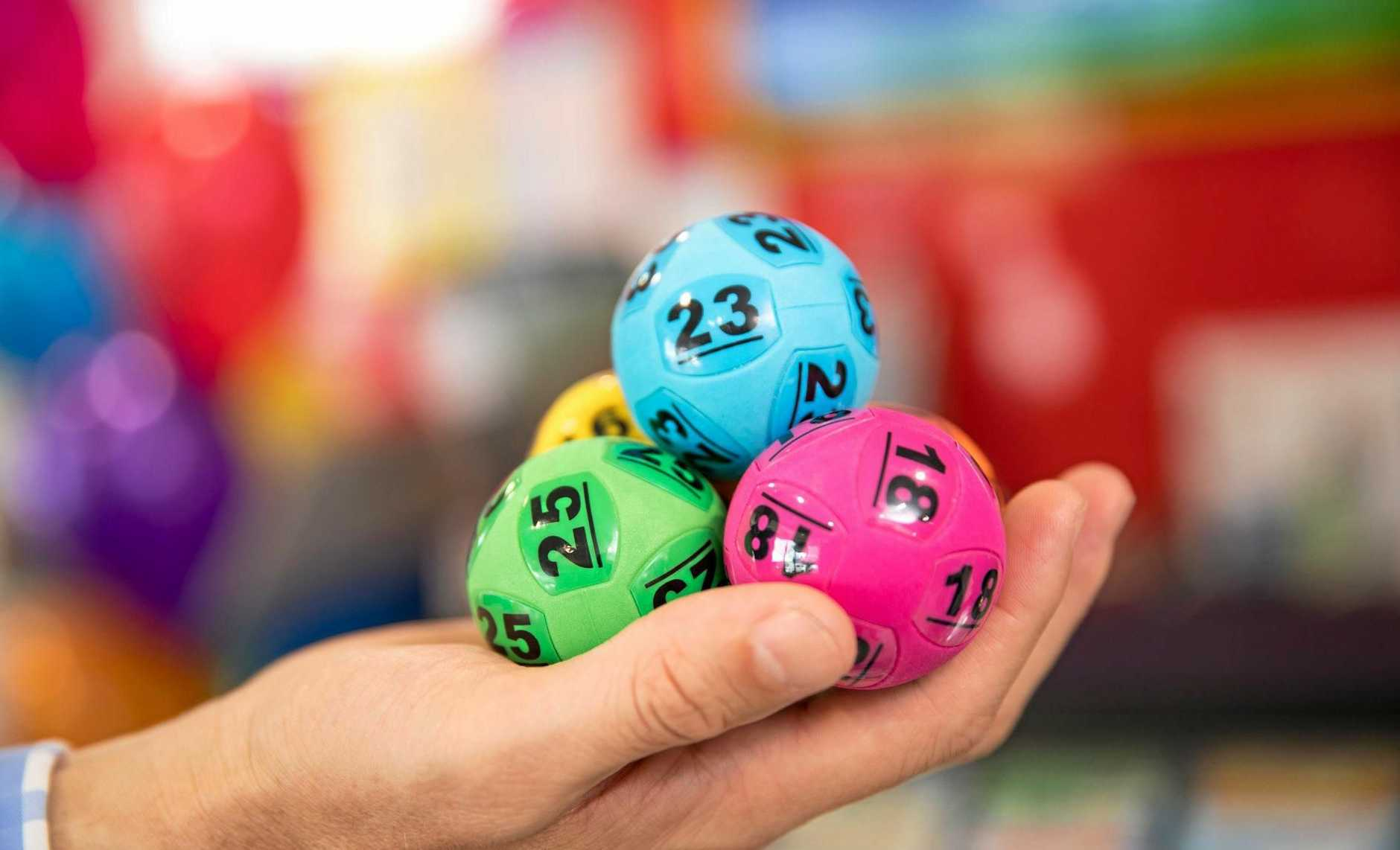 A Cooroy man and his two children will share in more than $600,000 from the division one prize.