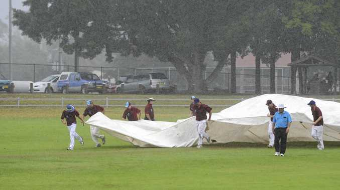 Cricket covers being rushed on at Ellem Oval.