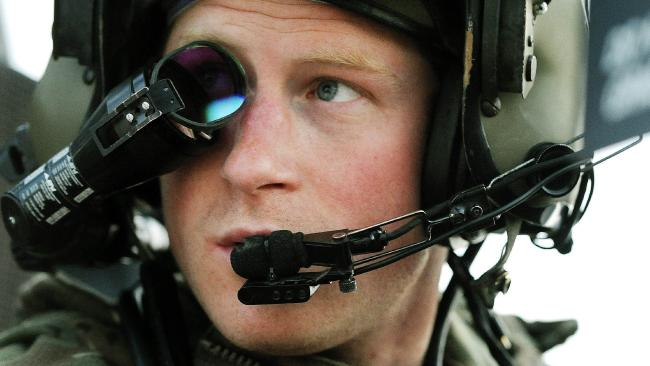 Britain's Prince Harry wearing his monocle gun sight as he sits in the front seat of his Apache Helicopter at the British controlled flight-line at Camp Bastion in Afghanistan's Helmand Province. Picture: John Stillwell