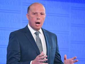 Abbott defends Dutton's remarks on South African farmers